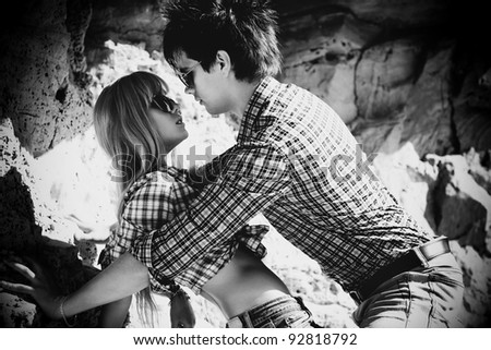 Young couple in love outdoors. Black and white. - stock photo