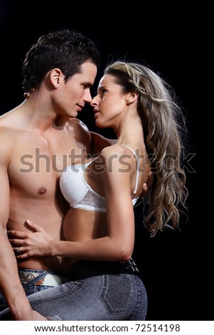 Young couple in love. Over dark  background