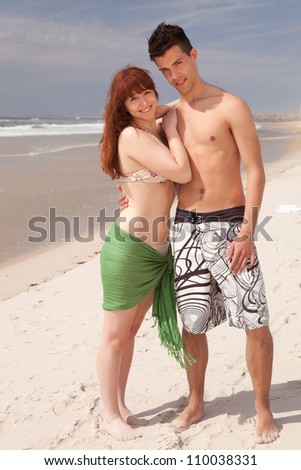 Young couple in love, relaxing at the beach