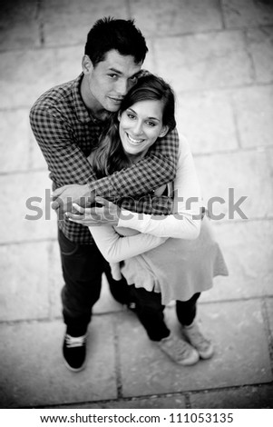 Young couple in love shot from above - stock photo