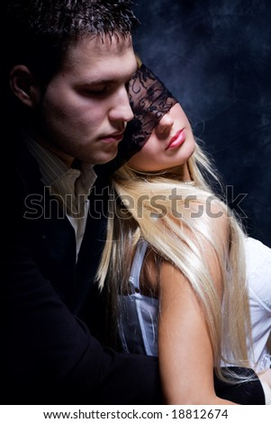 young couple in love, studio dark - stock photo
