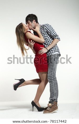 Young couple in love, studio portrait