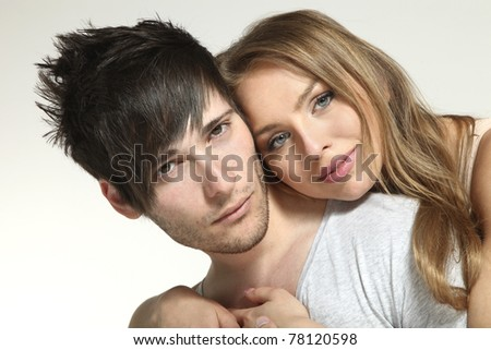 Young couple in love, studio portrait - stock photo