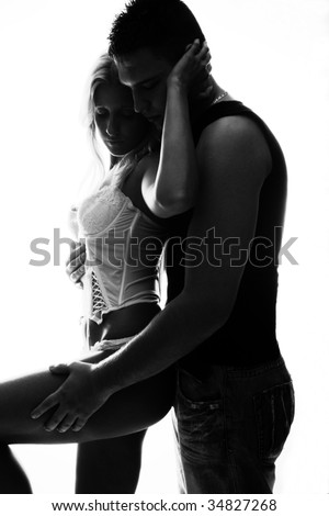 young couple in love, studio white, back light