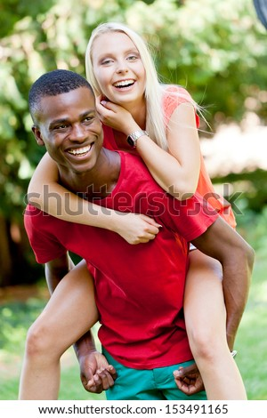 young couple in love summertime fun happiness romance outdoor colorful - stock photo