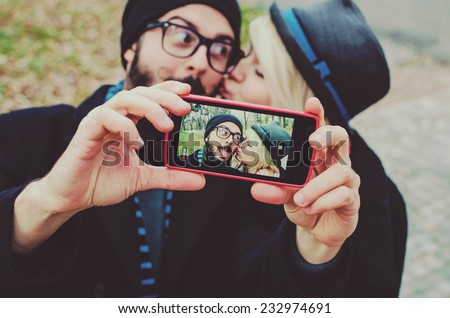 Young couple in love taking selfie - stock photo