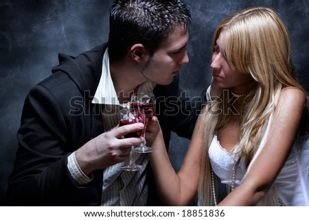 young couple in love toasting with wine - stock photo