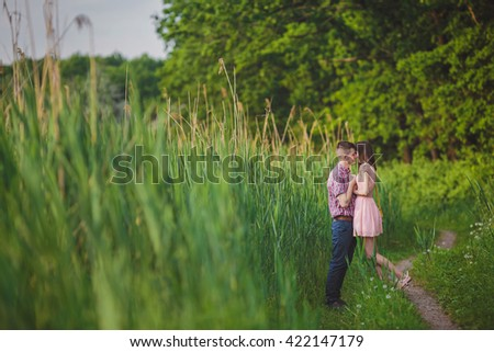 young couple in love together on nature in summer