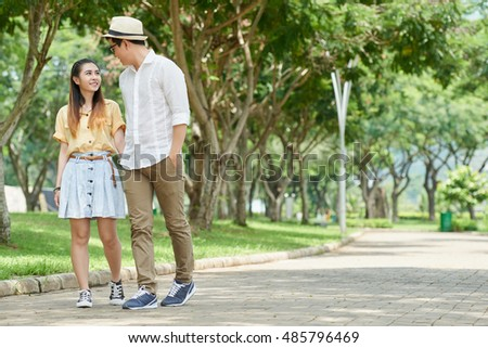Young couple in love walking in the park