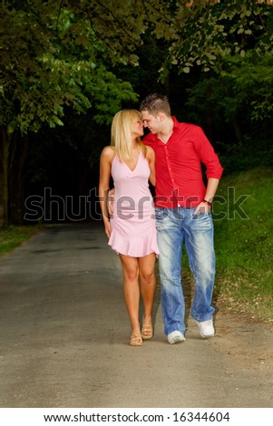 young couple in love walking through wood - stock photo