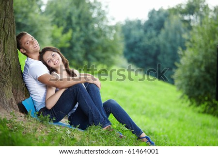 Young couple in love with a tree - stock photo
