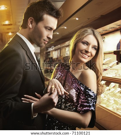 Young couple in love with store background - stock photo