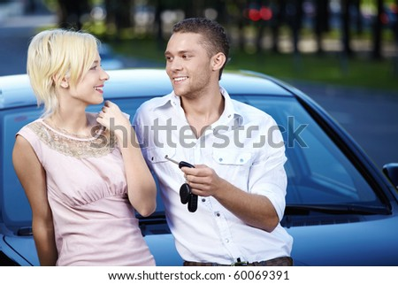 Young couple in love with the car keys