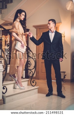 Young couple in luxury home interior - stock photo
