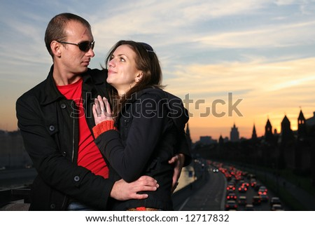 Young couple in Moscow city at sunset - stock photo