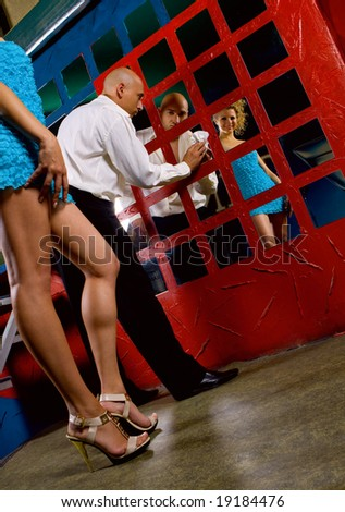 Young couple in night club interior - stock photo