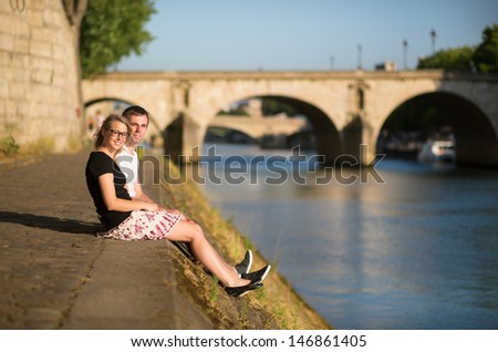 Young couple in Paris near the Seine - stock photo