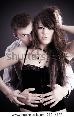 Young couple in passionate embrace - stock photo