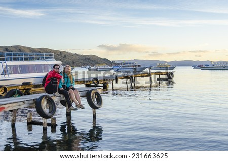 Young couple in port in Copacabana, Titicaca Lake, Bolivia - stock photo
