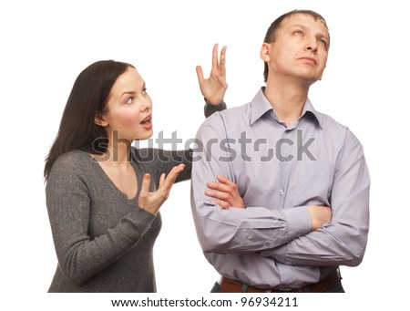 Young couple in quarrel. Wife yelling at her husband, isolated on white background - stock photo