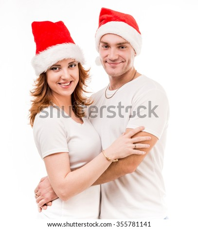 young couple in red santa hats isolated on white background