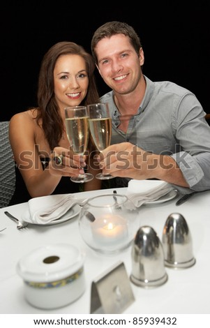 Young couple in restaurant - stock photo