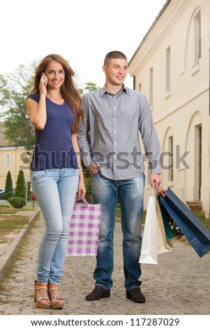 Young couple in shopping with the shopping bags - stock photo