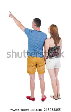 young couple in short pointing at wal Back view  (woman and man). Rear view people collection.  backside view of person.  Isolated over white background. - stock photo