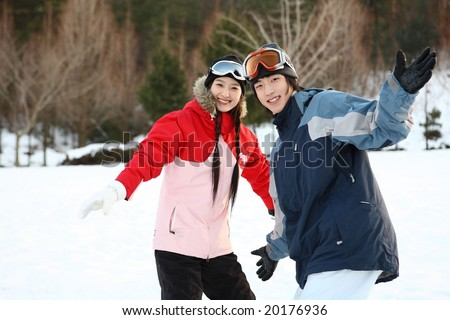 Young Couple in Ski - stock photo