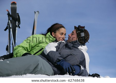 Young couple in snowy landscape - stock photo