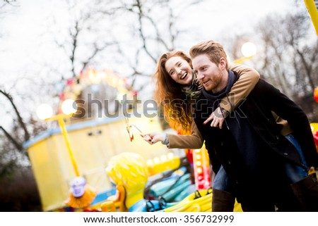 Young couple in the amusement park - stock photo