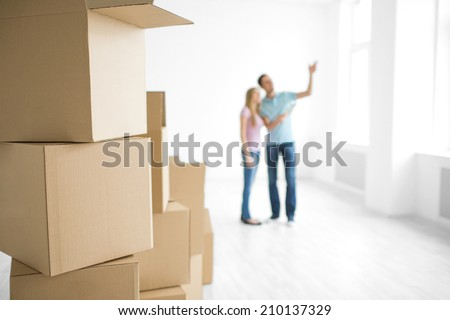 Young couple in the apartment - stock photo
