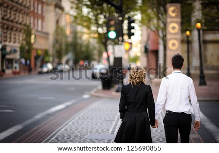Young couple in the city - stock photo