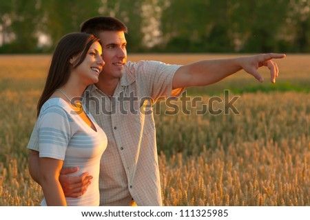 Young couple in the nature on sunny summer day. - stock photo