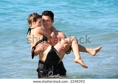 Young couple in the ocean - stock photo