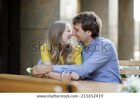 Young couple in the outdoor cafe  - stock photo