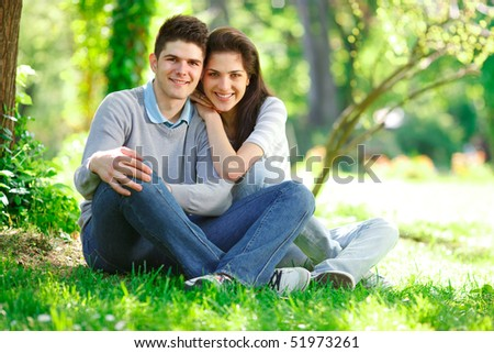 Young Couple in the park having fun