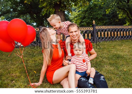 Young couple in the park with two kids