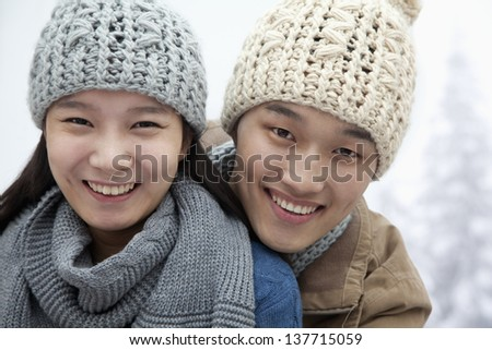 Young Couple in the Snow - stock photo