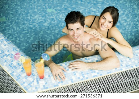 Young couple in the swimming pool - stock photo