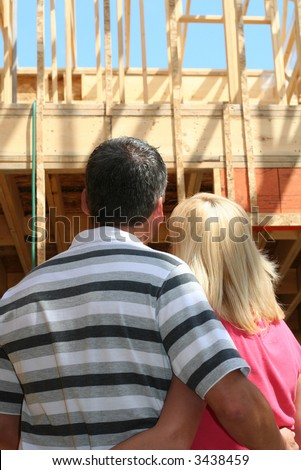 Young couple in their new home still under construction. - stock photo