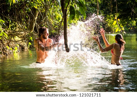 young couple in water - stock photo