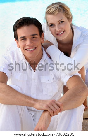 Young couple in white - stock photo