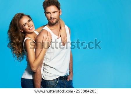 Young couple in white undershirts loving each other - stock photo