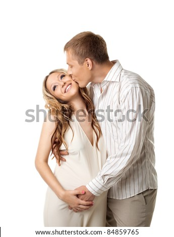Young couple in white wait for baby kiss a whife - stock photo