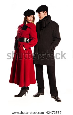 young couple in winter clothes, studio shot on white - stock photo