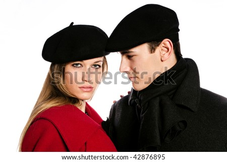 young couple in winter clothes studio white - stock photo
