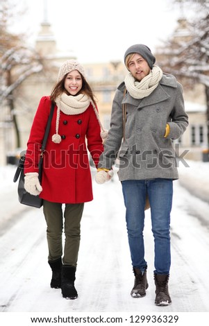 Young couple in winter setting - stock photo