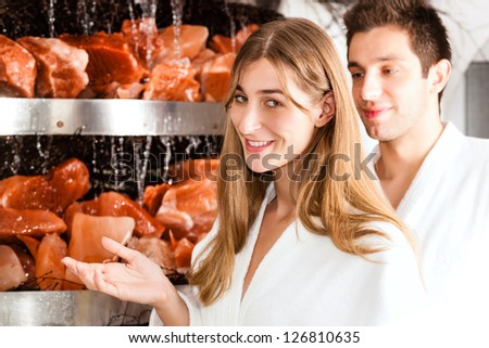 Young couple inhaling essential oil in salt cave of a Spa - stock photo
