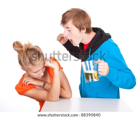 young couple is arguing, drunk man striking woman - stock photo